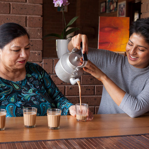 Uppma Virdi and her mother making chai together at a table
