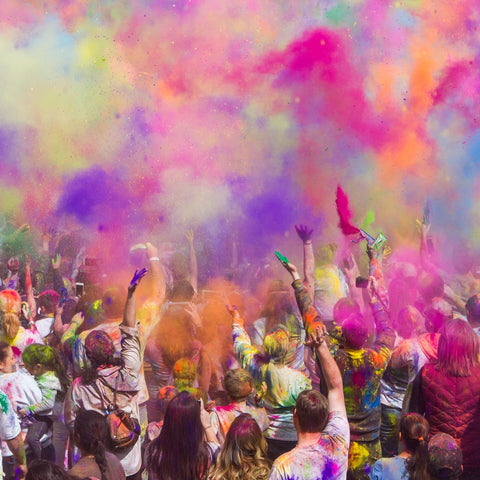 Coloured powders thrown into the air for Holi Festival in India