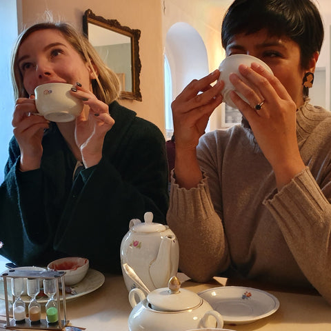 Krisi and Uppma drinking cups of tea.