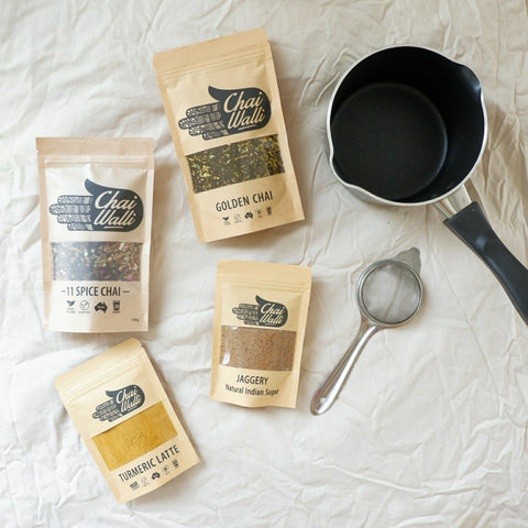 Chai Making Kit with two chai blends, jaggery, a strainer and a black chai pot