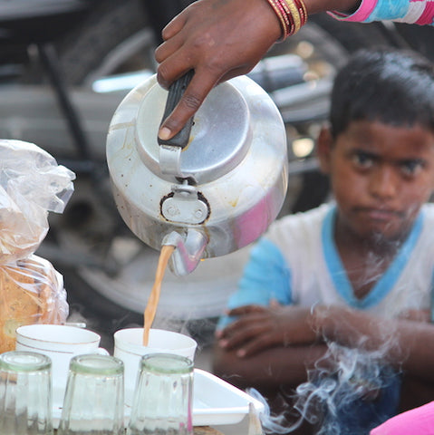 Authentic masala chai being served by a chai wallah in india