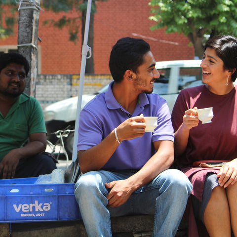 Uppma and friend in India drinking chai