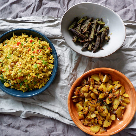 Uppma's indian rice dish next to cooked okra and dhal.