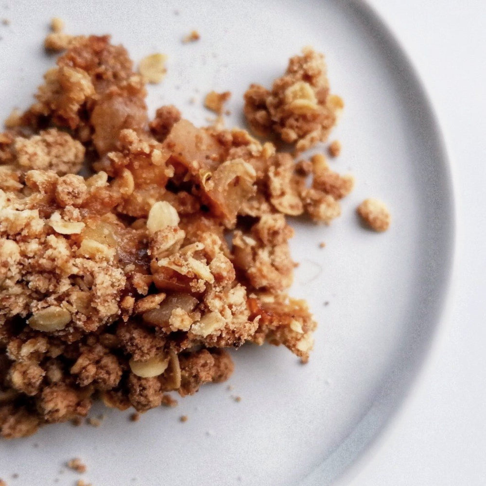 chai apple crumble in a dish made with the 11 spice chai sprinkles