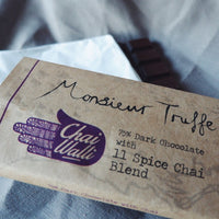 The Chai Walli Chai Cholcolate wrapper with Monsieur Truffle written on it along with the Chai Walli logo in purple