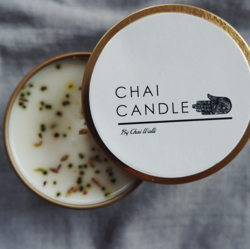Top view of the Chai Walli Chai Candle with the lid undone showing a partial view of the candle inside