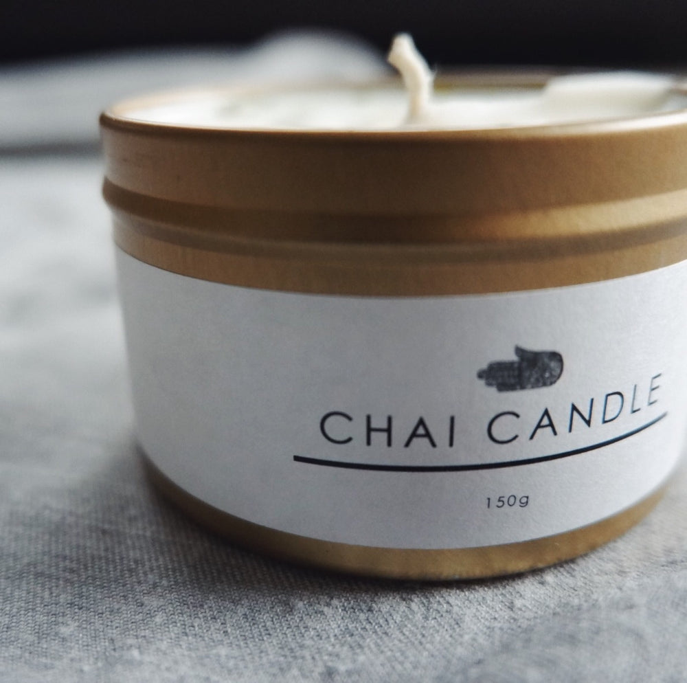 The Chai Walli Chai Candle golden jar without the lid on and the wick showing