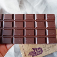 The Chai Walli  Chai Chocolate bar placed on top of its wrapper