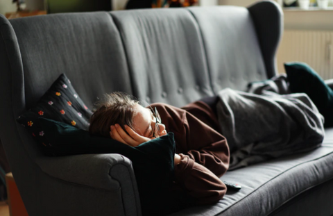 a person working at home, taking a nap