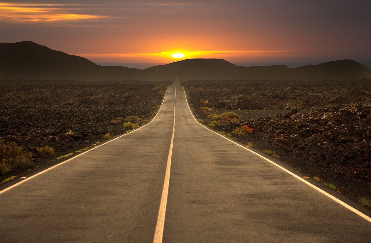 Sun Set on a road while travelling