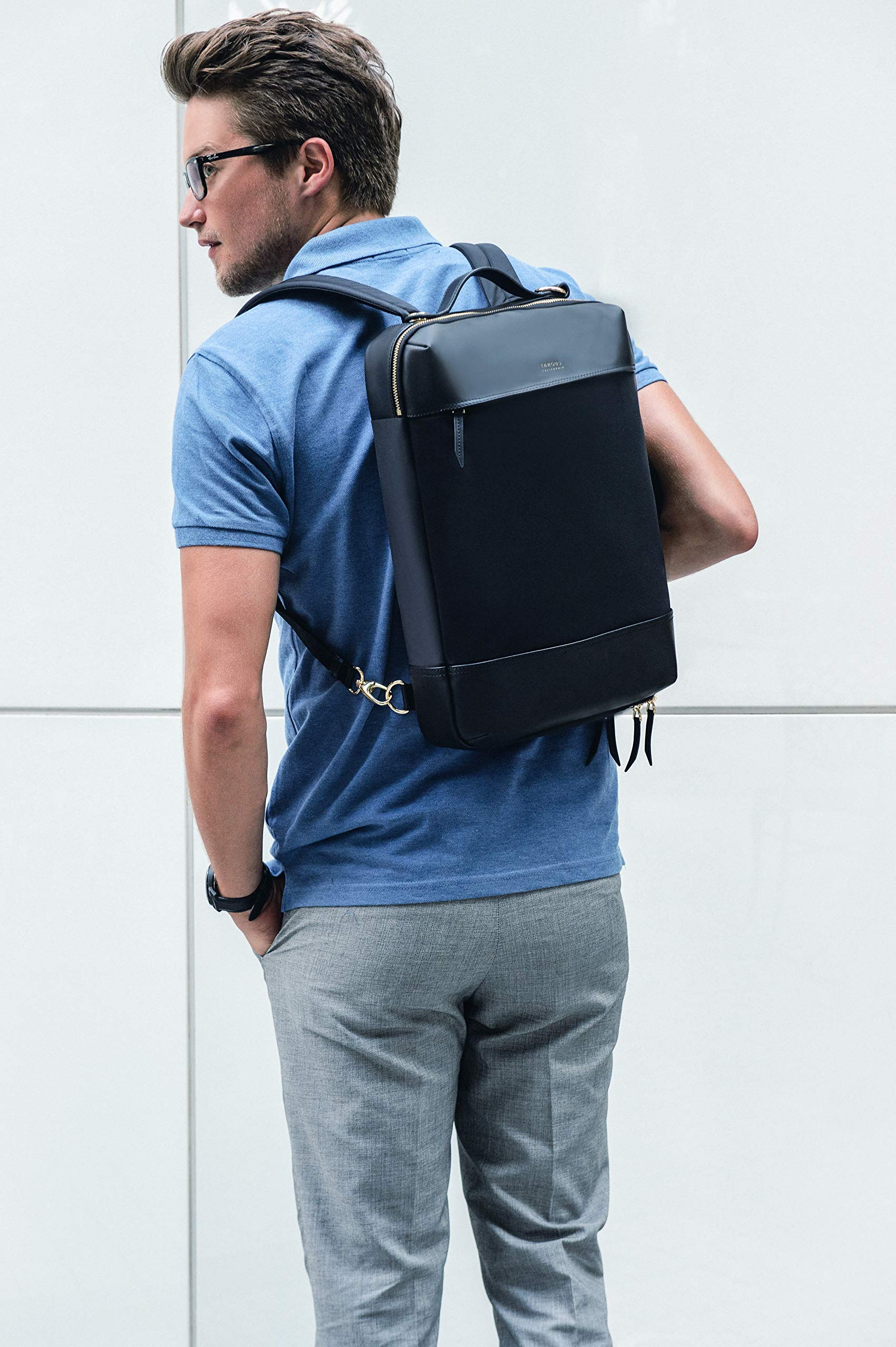 Man carrying laptop backpack