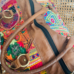 Embroidered leather overnight bag
