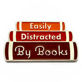 enamel pin easily distracted by books