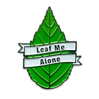 enamel pin that reads Leaf Me Alone