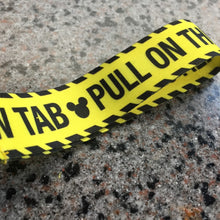 Pull on the Yellow TAB 1/4 Lanyard Strap