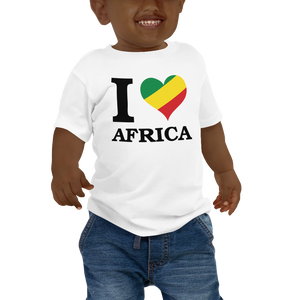 This white short-sleeved baby T-shirt from Natty Wear is made of 100% cotton*. The front print portrays the capital letter 'I' in black color, followed by a heart symbol (❤) in the Rastafarian colors (red, gold/yellow, green), which are also known as the Pan-African colors, below is the word 'AFRICA' set in capital letters in black color