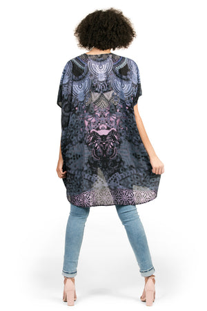 Kimono by Kalisi, inspired by Africa, the dashiki, the animal kingdom and strength.