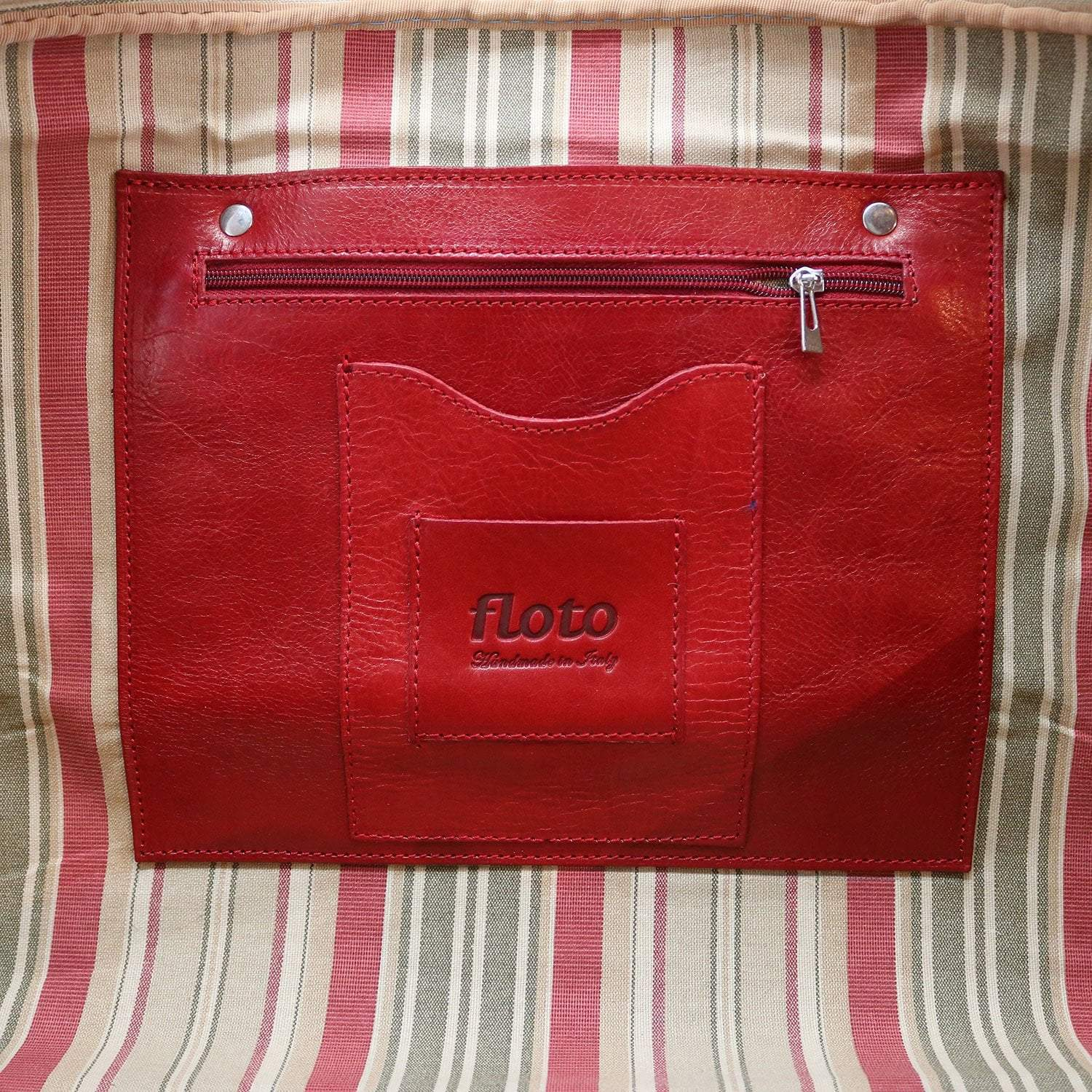 Floto Venezia Leather Travel Duffle Bag 2.0 - Tuscan Red showing Detail View of Inside Tag