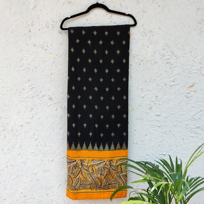 Pure Cotton Black Ikkat With Yellow Kalamkari Leaves Border Block Printed Woven Fabric