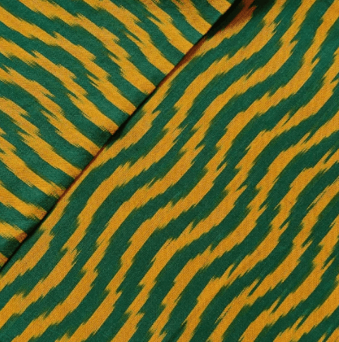 Pure Cotton Hand Woven Ikkat With Green And Mustard Meandering Weaves Fabric