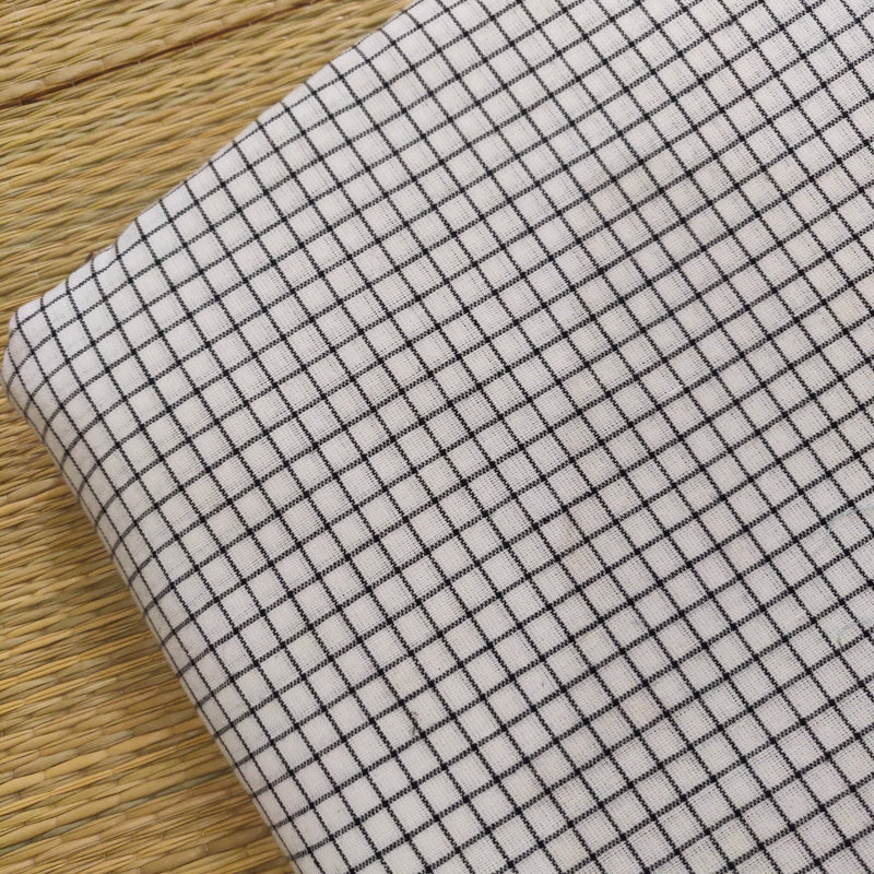 Pure Cotton White With Black Checks Woven Fabric
