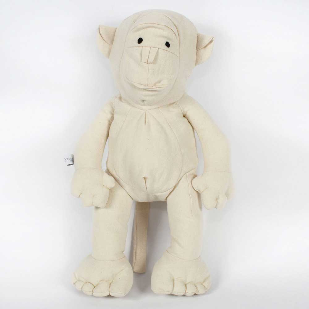 Child holding Severina Kids Off White Cotton Monkey