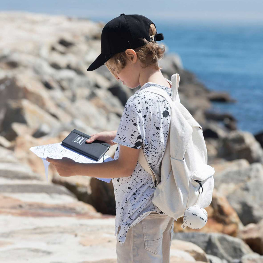Boy by the sea with backpack and globe - Severina Kids