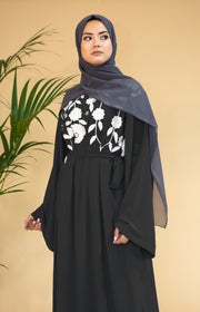 Aaliya Collections Black Floral Abaya in classic black with stunning contrasting white floral finishing