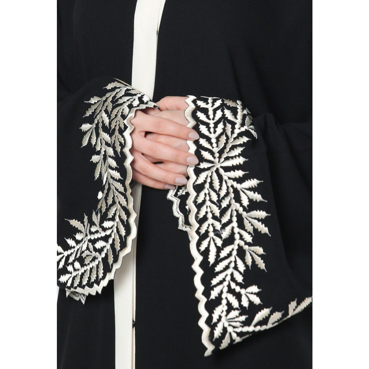 Close up of Aaliya Collections Akila Abaya in beautiful black colour with leaf embroidery on hem and sleeves