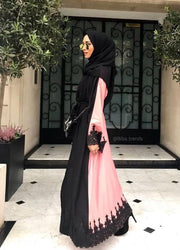 Aaliya Collections Two Tone Lace Abaya in Black and Pink finished with a pretty black lace hem and black lace sleeves