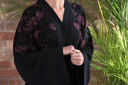 Aaliya Collections A classic black abaya with contrasting burgundy floral embroidery