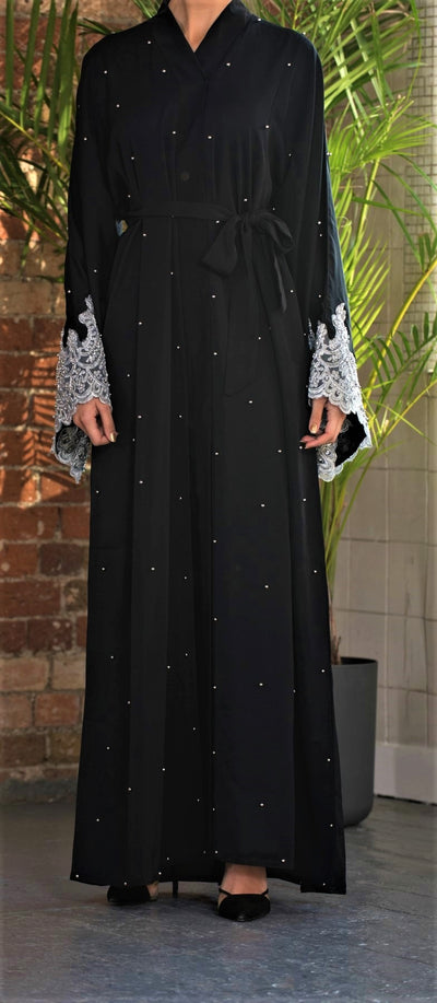 Aaliya Collections Sabah Abaya Black A truly stunning abaya of luxurious Black Nidha fabric with scattered pearls and a gorgeous silver lace finish