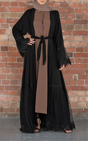 Aaliya Collections Irum abaya Classic black with additional layers of net giving the abaya volume and grace, complete with pretty lace trimming at the sleeves.