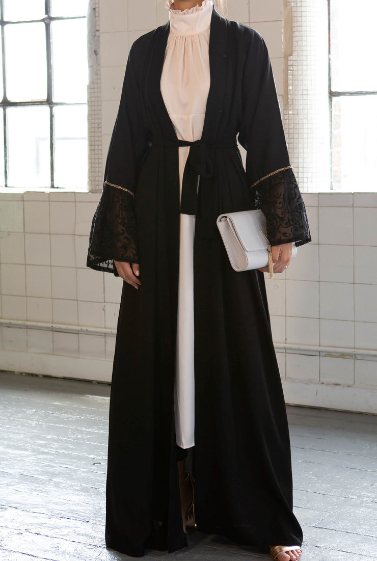 Aaliya Collections Black Bell Sleeve Abaya with contrasting lace sleeves bordered with striking gold sequin trimming