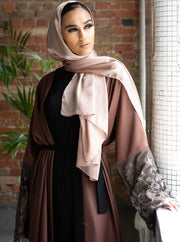 Aaliya Collections Tawny Lace Abaya A warm tone abaya with a contrasting black border and gorgeous lace finish. Perfect for evenings out, this piece is ideal for Occasion Wear