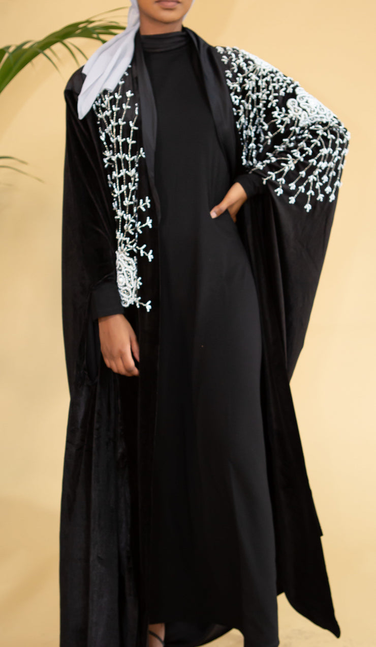 Aaliya Collections Pearl Embellished Cape  A breathtaking velvet cape with intricate pearl embellishment detailing, creating a statement look for your next special occasion!