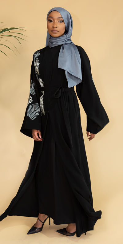 Aaliya Collections Grey Leaf Abaya Created with contrast in mind, a stunning black abaya with gorgeous grey shades in leaf embroidery