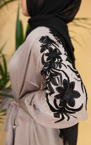 Aaliya Collections Grey Noir Abaya Aaliya Collections Grey Leaf Abaya Created with contrast in mind, a stunning black abaya with gorgeous grey shades in leaf embroidery