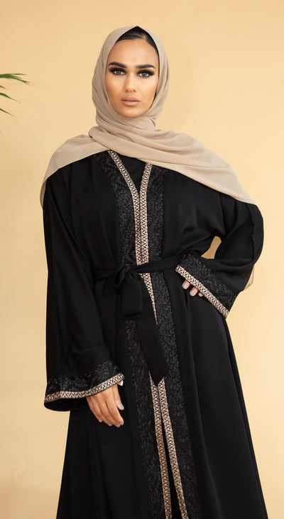 Aaliya Collections Hidaya Abaya A beautiful black abaya with a gorgeous contrast of gold and black leaf bordering