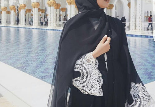 Aaliya Collections Hayaa white lace abaya in plain black with vintage white lace on sleeve and hem