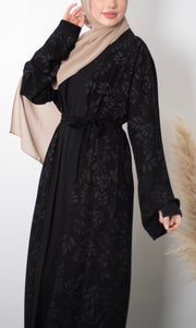 Aaliya Collections Create an effortless look with the Hanan Abaya, classic black with beautiful leaf embroidery.