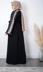 Aaliya Collections Reem Embroidered Abaya An elegant classic black abaya with beautiful embroidery on the upper bodice