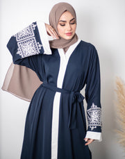 Aaliya Collections Manal Abaya A closed beautiful navy abaya with contrasting white embroidery on the sleeves and back!