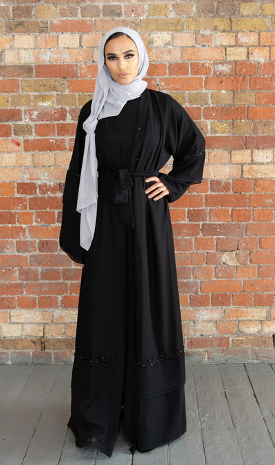 Aaliya Collections georgette sequin abaya A stunning Classic Black abaya with a layering affect creating elegance and class finished with intricate sequin detailing