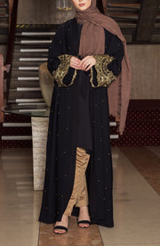 Aaliya Collections Saaiqa Abaya A stunning classic black abaya with pretty gold lace and pearl detailing