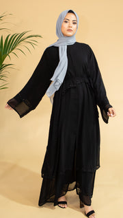 Aaliya Collections Black Sequin Abaya A gorgeous lightweight black abaya with an overlay of a flowy second layer with gorgeous black sequin detailing.