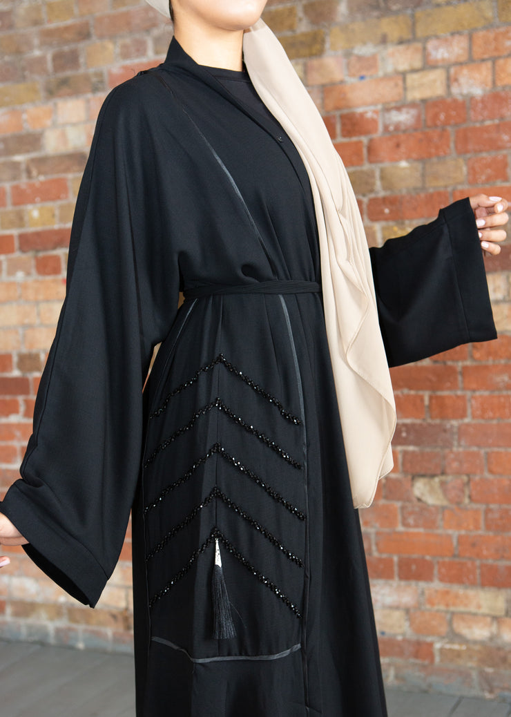 Aaliya Collections Tassle Sequin Abaya A Classic Black Abaya with gorgeous detailing of sequins and tassles creating an elegant and classy finish