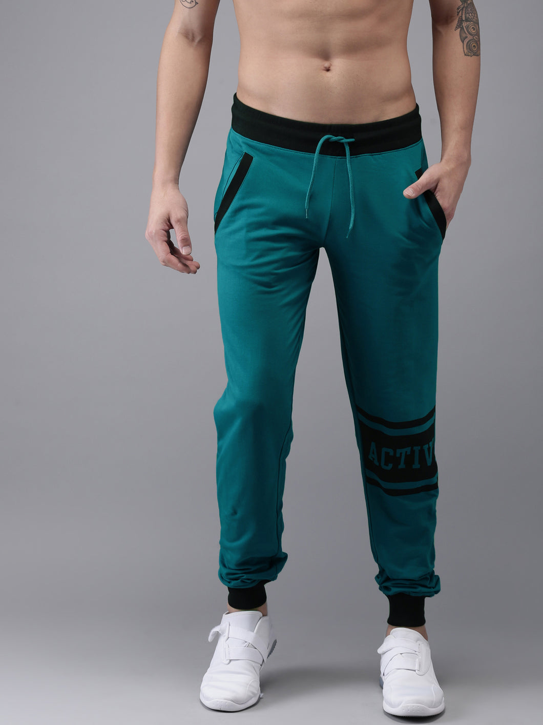 Men Teal Blue Solid Joggers Joggers PRICE : Rs.749 | Book For Rs.31 Only