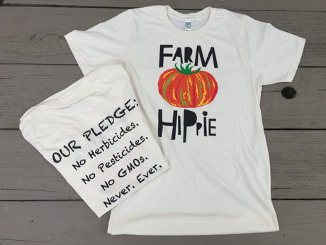 Farm Hippie Organic T-Shirt with Our Pledge of No Herbicides, No Pesticides. Natural color shirt with a striped red, orange, yellow, green tomato.