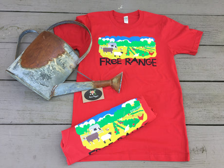 Free Range organic T-shirt part of our farm advocacy collection. Cherry red shirt with a farm scene.